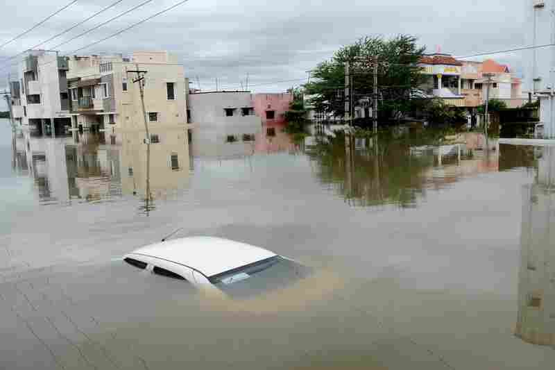 Submerged cars and stalled mass transport have left thousands of residents stranded in Chennai.