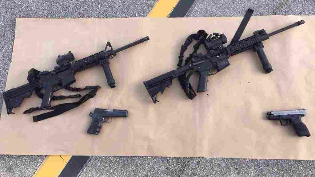 A photo provided from the San Bernardino County Sheriff's Department shows four guns near the scene of a shootout in which Tashfeen Malik and Syed Rizwan Farook were killed. The deadly attack the pair carried out has prompted new calls for tighter gun control laws in the U.S.
