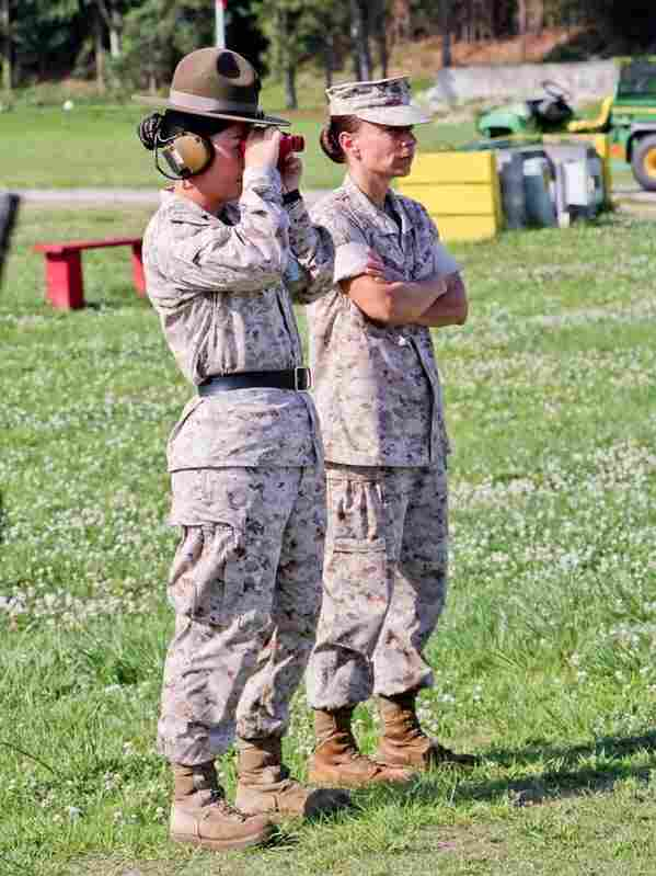 Lt. Col. Kate Germano (right, arms crossed) stands beside Sgt. Lindsey Rodriguez.