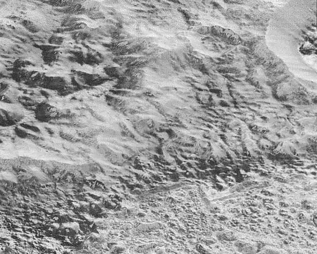 """The highest-resolution images to come from New Horizons shows what NASA calls Pluto's """"Badlands,"""" an area that shows show how erosion and faulting have sculpted the icy crust into a rugged topography."""