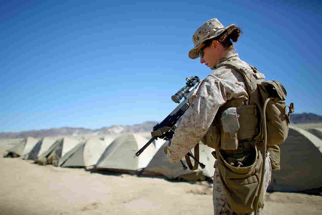 Sgt. Kelly Brown puts her weapon over her shoulder at the Marine base at Twentynine Palms, Calif., in March. On Thursday, Secretary of Defense Ash Carter announced that women would be allowed to serve in combat jobs.