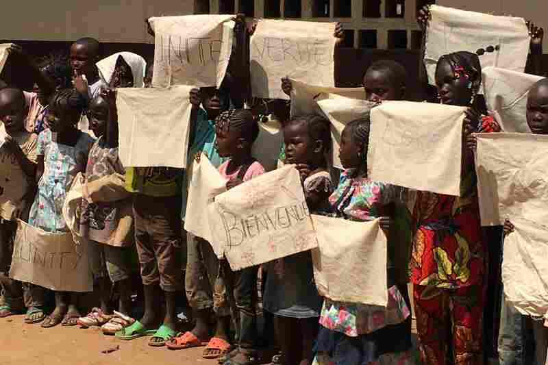 Children prepare to welcome Pope Francis at the Saint Sauveur displaced persons camp in Bangui, Central African Republic.