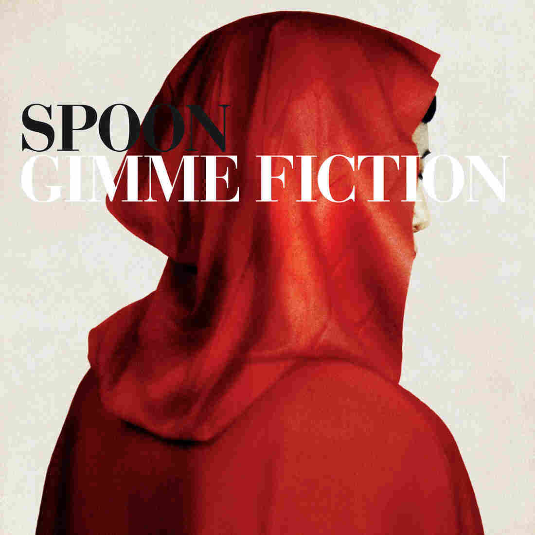 The cover art for Spoon's Gimme Fiction depicts a mysterious figure based on Red Riding Hood.
