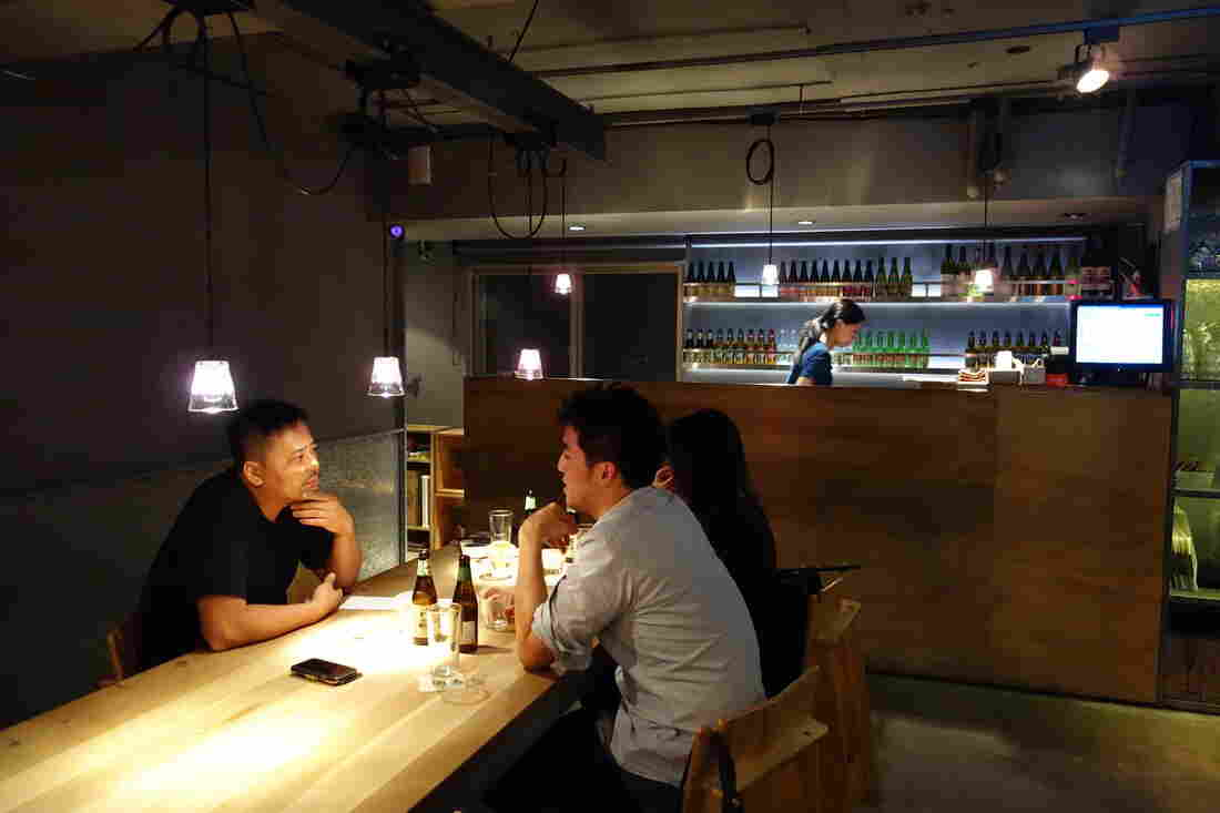 Taiwanese-Australian entrepreneur Jimmy Yang (left) spends much of his time at his Taipei restaurant and bar, Woolloomooloo. Many younger Taiwanese are focused on work they see as creative and innovative.