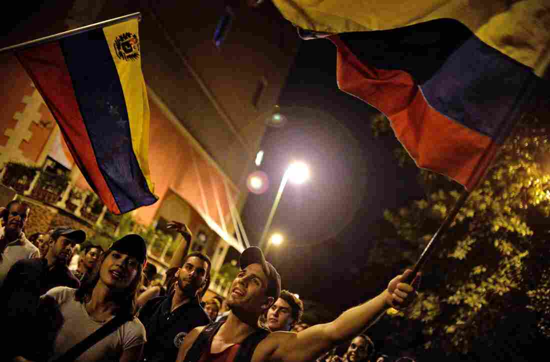 Venezuelan opposition supporters celebrate the results of the legislative election in Caracas early Monday.