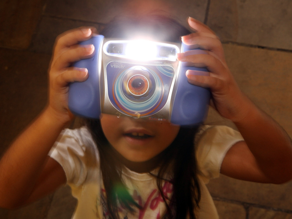 Charlize, 8, plays with the Kidizoom Multimedia Digital Camera made by VTech in 2009. A recent data breach hacking sensitive information, including kid's photos, is prompting parents to look twice at their children's technology usage. (Oli Scarff/Getty Images)