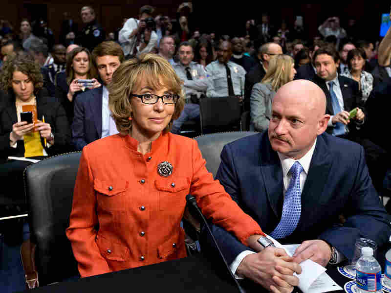 Gabrielle Giffords sits with her husband, Mark Kelly, at a Senate Judiciary Committee hearing on in 2013.