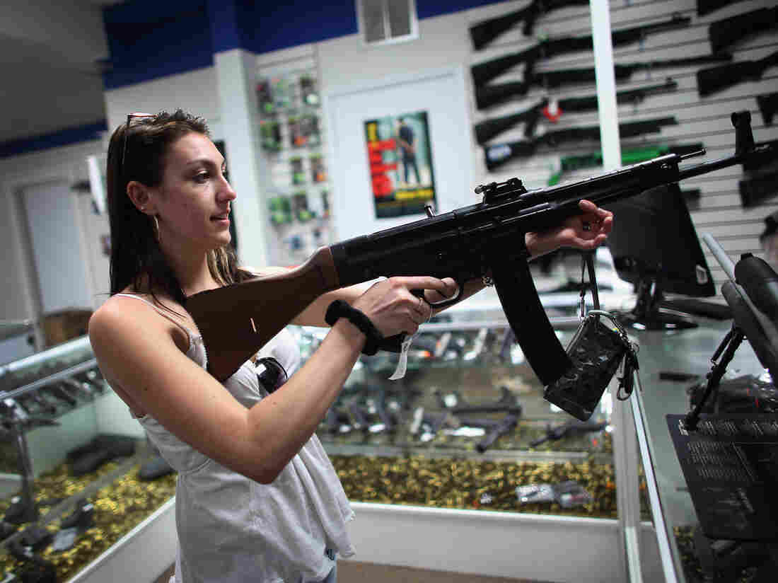 Cristiana Verro looks at guns on sale at the National Armory gun store on April 11, 2013 in Pompano Beach, Florida.