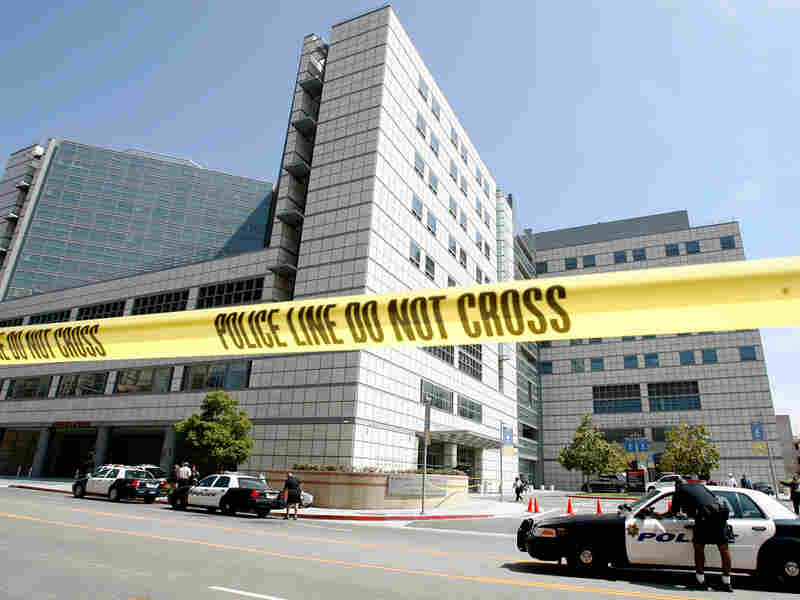 Police tape hangs across the street near the emergency room dock at UCLA Medical Center in Los Angeles, where Michael Jackson was brought after he stopped breathing.