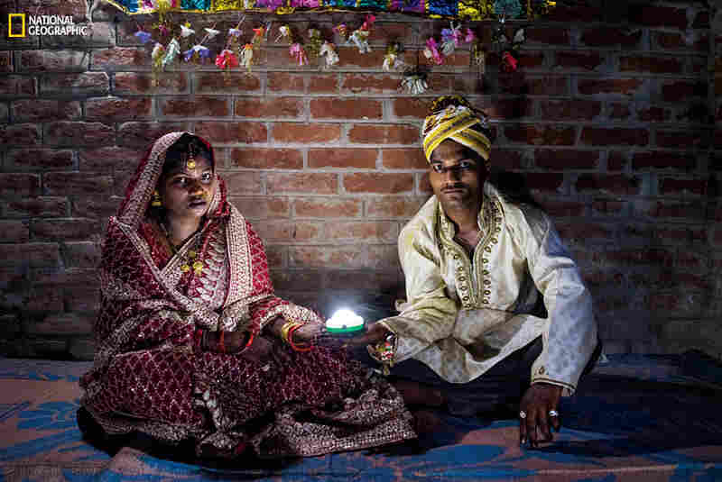 Holding a solar-powered lamp, Soni Suresh, 20, and Suresh Kashyap, 22, celebrate their marriage ceremony in Uttar Pradesh, where 20 million households lack electricity.