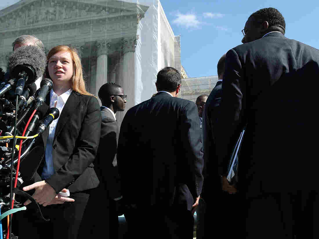 Abigail Noel Fisher, who challenged a racial component to University of Texas at Austin's admissions policy, speaks to the media outside the U.S. Supreme Court building during arguments in the case in October of 2013.