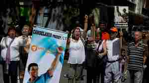 "Supporters of Venezuelan opposition leader Leopoldo Lopez shout ""Freedom for Leopoldo"" outside a court in Caracas in September. Lopez, Venezuela's best known political prisoner, was arrested and sentenced to nearly 14 years in prison after giving a speech at a demonstration last year."