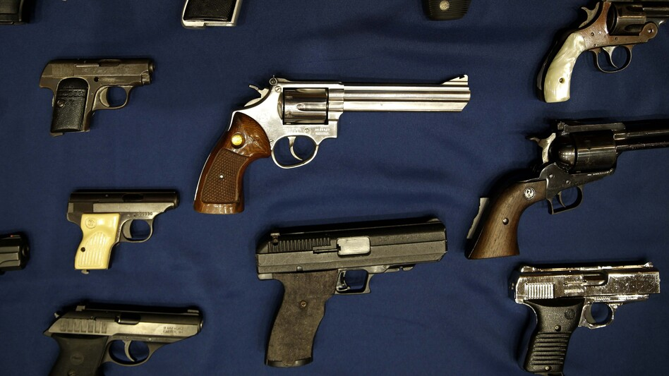 Guns seized by the police are displayed during an Oct. 2015 news conference in New York. (Seth Wenig/AP)