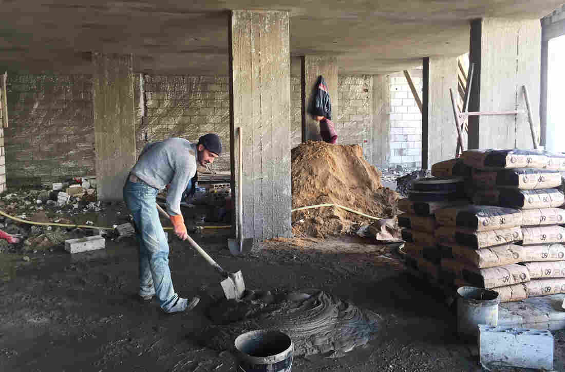 Radwan Mahmoud, a Syrian refugee, works as a laborer on a construction site in Lebanon. He's supporting 12 family members and earning about $16 a day. With a population of just over 4 million, Lebanon is host to more than 1 million Syrian refugees.