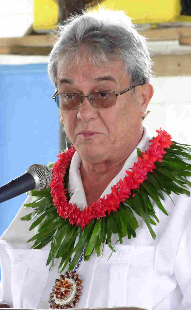 "De Brum says that the long-term goal of the climate summit, keeping temperature increases below 2 degrees Celsius, would still be a disaster for his country. Its slogan is ""1.5 to stay alive."" He's shown here at a 2013 climate meeting in the Marshall Islands."