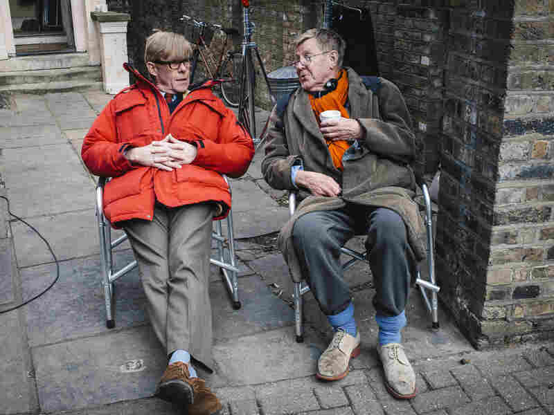 Playwright Alan Bennett (right) sits with actor Alex Jennings on the set of The Lady in the Van. Bennett's plays include The Madness of George III and The History Boys.