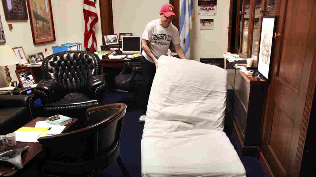 """Rep. Mike Quigley, whose Washington, D.C. office doubles as his home away from Chicago, lays his mattress onto the floor before going to sleep. While some see a political benefit, """"it's not something I'm thrilled about,"""" Quigley said. """"It's just circumstances."""""""