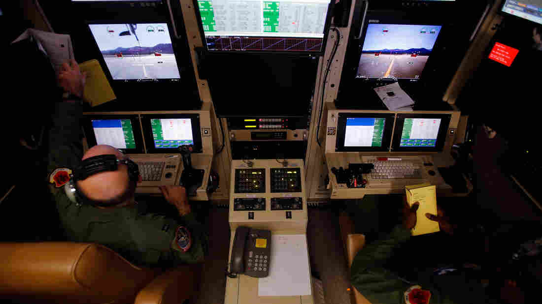Airmen use a ground-control station cockpit to control remotely piloted aircraft Nov. 17 during a training mission at Creech Air Force Base in Indian Springs, Nev. The Pentagon plans to remotely piloted aircraft flights by as much as 50 percent in the next few years to meet increased needs for surveillance, reconnaissance and lethal airstrikes around the world.