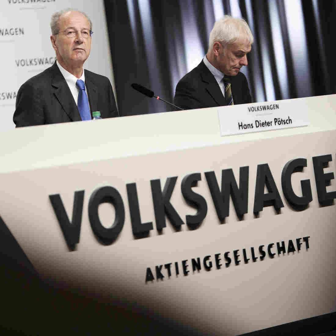 Volkswagen Chairman Hans Dieter Pötsch (left) and CEO Matthias Müller attend a news conference Thursday in Wolfsburg, Germany, to announce the latest update in the company's handling of its emissions scandal.