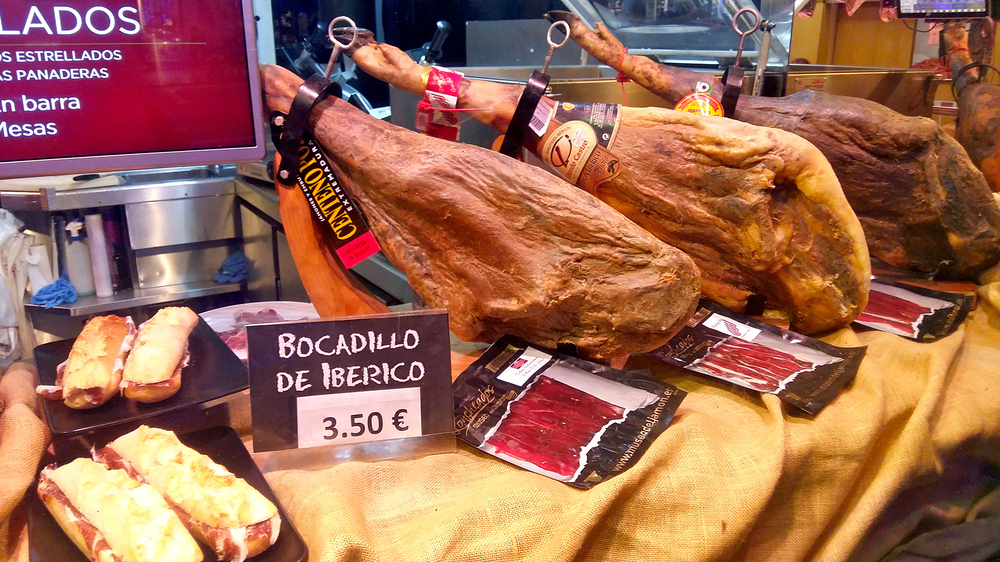 Display of Spanish hams in the front window of a branch of the Museo del Jamón, a chain of ham-themed bars in Madrid.