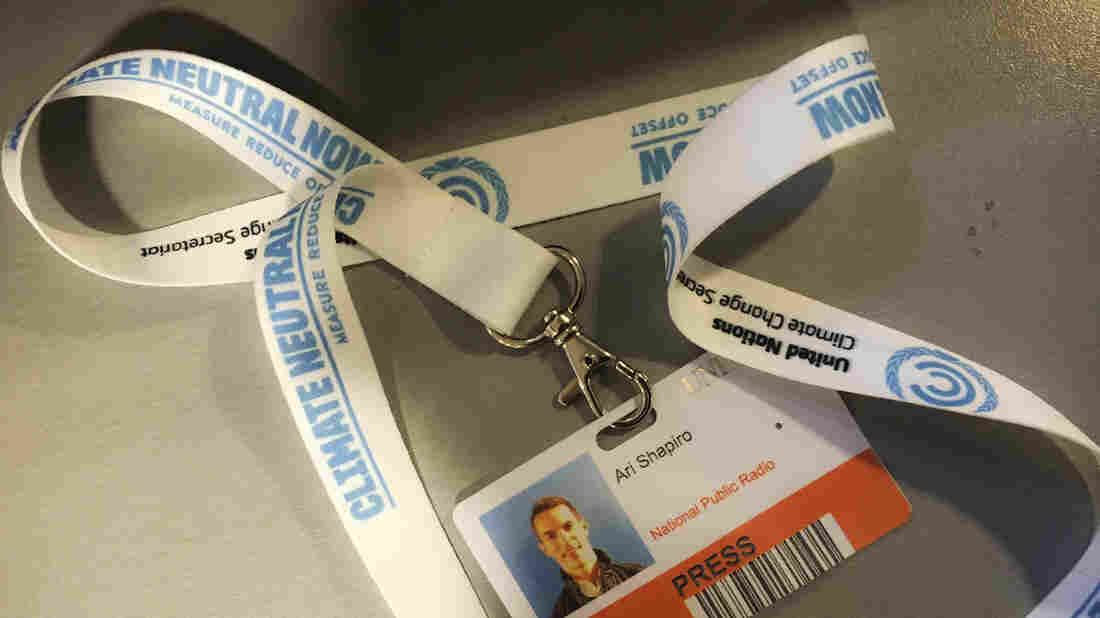 "The round-trip flight that NPR's Ari Shapiro took to Paris emitted about a ton of greenhouse gases. Offsetting it cost a dollar, and he was given a white lanyard for his conference ID with the words ""Climate Neutral Now"" showing his trip was carbon-neutral."