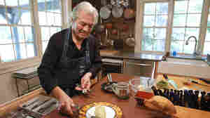 Chef Jacques Pépin places silverware on a plate with an omelet at his home in Madison, Conn.