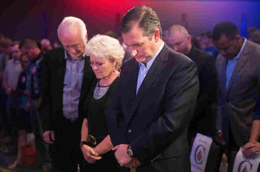 """Republican presidential candidate Sen. Ted Cruz prays before the start of his Religious Liberty Rally in Des Moines, Iowa, in August. He is among the Republican candidates who say there is a """"war on faith"""" in America."""