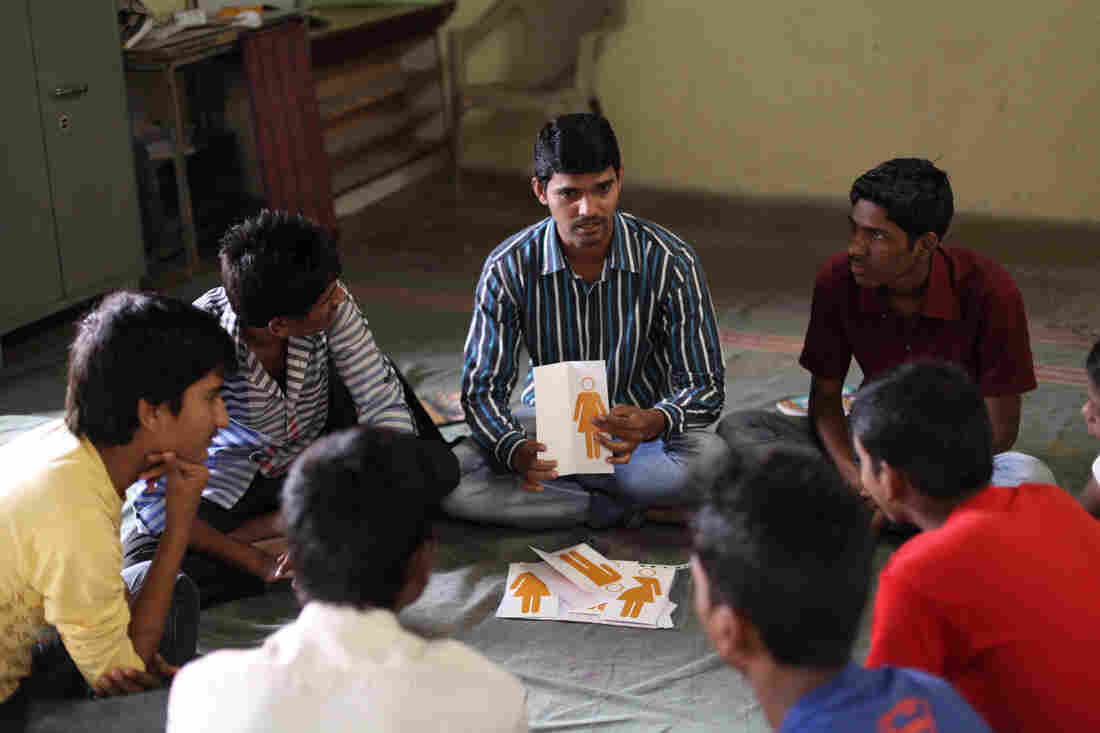 It's a three-hour class, once a week for 15 weeks. A mentor (center) leads the teen boys in a discussion.