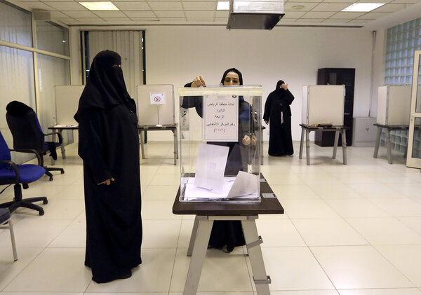 Saudi women vote at a polling center during municipal elections, in Riyadh, Saudi Arabia on Saturday. Saudi women are heading to polling stations across the kingdom, both as voters and candidates, for the first time in this landmark election.