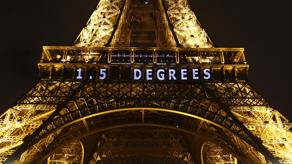 """One target for limiting global warming — """"1.5 DEGREES"""" — is projected on the Eiffel Tower on Friday as part of the United Nations Climate Change Conference in Paris. (Francois Mori/AP)"""