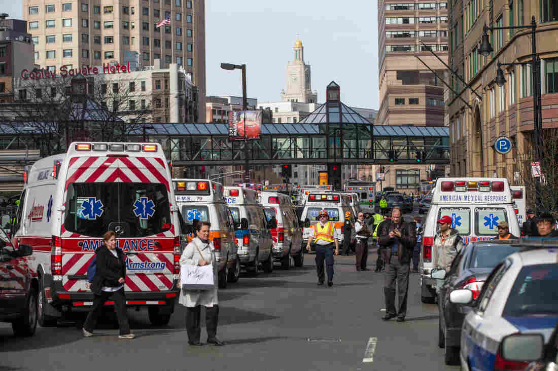 Ambulances lined up following two explosions near the finish line of the Boston Marathon on April 15, 2013.
