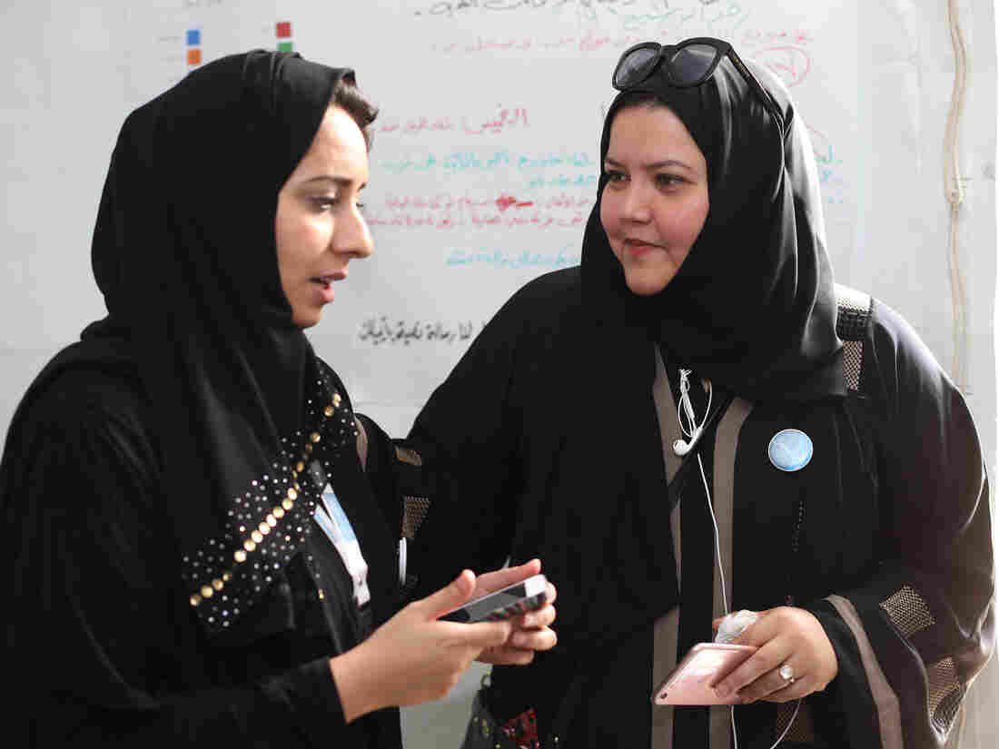 Jeddah activist Rasha Hefzi, right, shown here with Hanaa Amer, the head of her communications team, won a municipal council seat as the youth candidate. This was the first time Saudi women were allowed to vote, and women won 20 of 2,000 positions in municipal elections. Many women called it a step forward, but said they still face many obstacles in the kingdom.