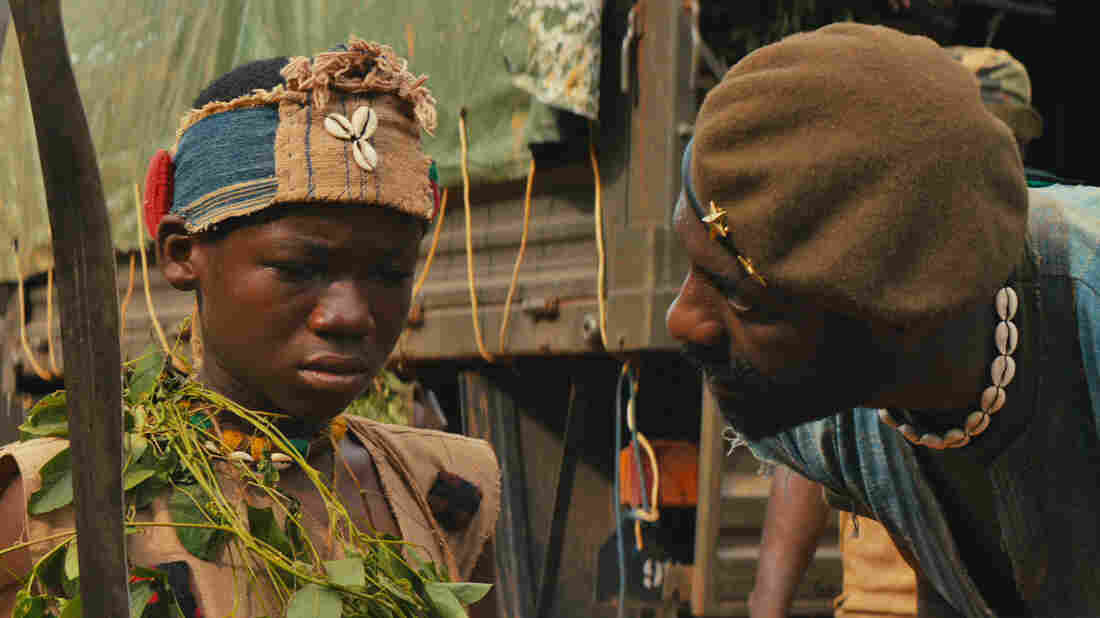 Abraham Attah plays a child soldier and Idris Elba is his commander in Cary Fukunaga's Beasts of No Nation.