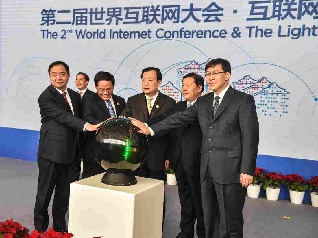 """China's Cyberspace Administration minister Lu Wei (second from right) and other officials attend the opening ceremony of the Light of the Internet Expo on Tuesday as part of the Second World Internet Conference, which starts Wednesday. Lu has said that controlling the Internet is about as easy as """"nailing Jell-O to the wall."""""""