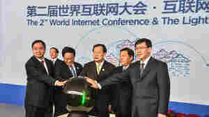 "China's Cyberspace Administration minister Lu Wei (second from right) and other officials attend the opening ceremony of the Light of the Internet Expo on Tuesday as part of the Second World Internet Conference, which starts Wednesday. Lu has said that controlling the Internet is about as easy as ""nailing Jell-O to the wall."""