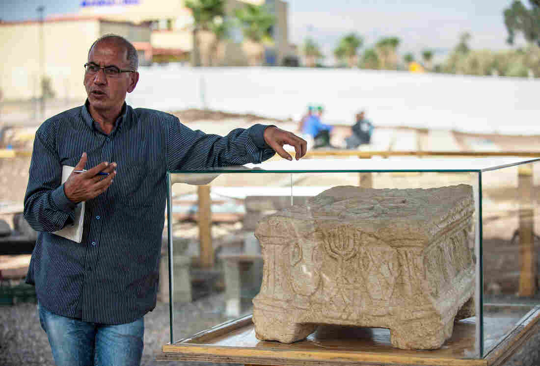Arfan Najar, an archaeologist at the Israel Antiquities Authority, introduces a replica of the Magdala Stone at the Magdala Archeological Park in Israel on Dec. 2, 2013.