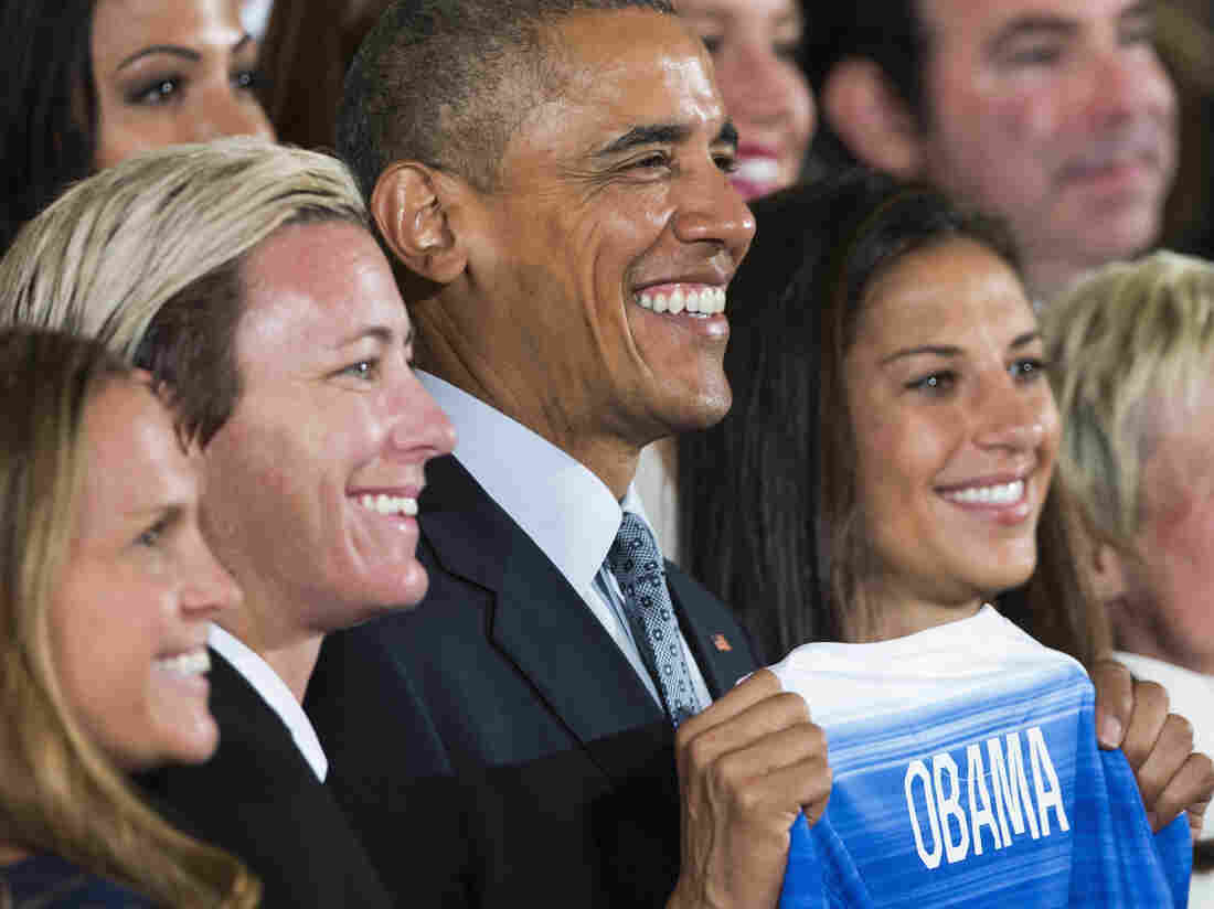 President Barack Obama with Christie Rampone (left) Abby Wambach (center), and Carli Lloyd (right) at the White House.