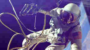 Ed White completes the first American space walk in 1965.