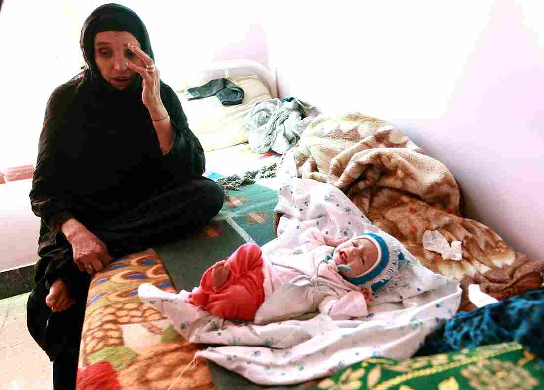 A mother with her malnourished infant at a feeding center in Sanaa, Yemen. According to UNICEF, over a million Yemeni children under age 5 are at risk of malnutrition.