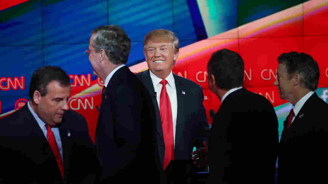 In the end, Tuesday's debate seemed to do little to scramble the standings ahead of the holidays — eyes were mostly, once again, on Donald Trump (center).