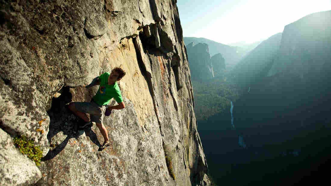 Alex Honnold, free soloing up a cliff face