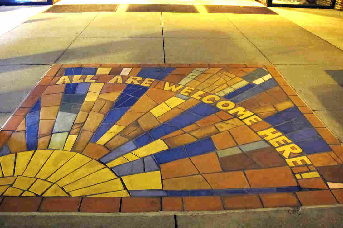 "A mosaic in the sidewalk in front of Countryside United Church of Christ in Omaha. ""We love our building. There is literally no good reason to move whatsoever, except to follow this Tri-Faith Initiative,"" says the Rev. Eric Elnes."