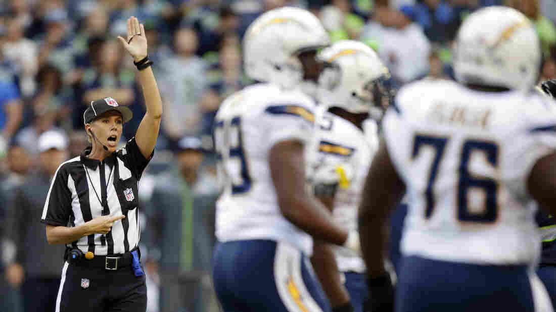 Sarah Johnson makes a call during a preseason football game. Our story about Johnson becoming the NFL's first full-time female game official was one of the Two-Way's most-shared posts of 2015.