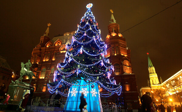 A New Year tree stands outside the Kremlin in Moscow, in 2008. Shown from right in the background are: the Kremlin's St. Nicholas Tower, the Historical Museum, and the monument to Soviet Marshal Georgy Zhukov.