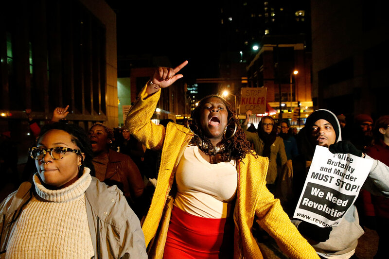 Protesters march through the streets after a mistrial was declared in the trial of Baltimore police Officer William G. Porter on Wednesday. (Rob Carr/Getty Images)