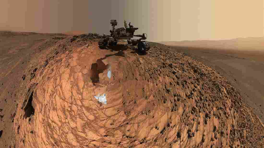 "After it drilled two holes in the ""Buckskin"" rock on Mars, the Curiosity rover took a series of photos that were turned into this panoramic self-portrait. The rover is sitting on the crest of a 20-foot hill."