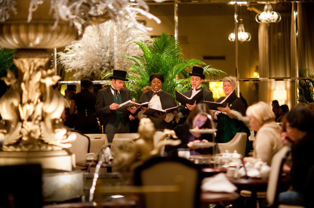 Carolers sing during Christmas tea at the Drake Hotel in Chicago. In some fancy hotels, Christmas tea has become a refined respite for harried holiday shoppers. But the tradition's roots are much rowdier: efforts to fight public drunkenness.