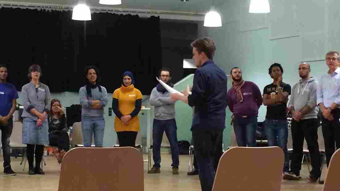 Members of Berlin's recently formed Begegnungschor Choir (Getting To Know You Choir) rehearse. The 50-person choir is made up equally of Germans and asylum seekers, who are from Syria and Eritrea.