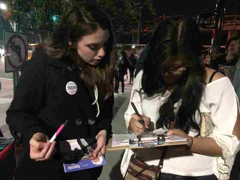 Volunteer Belen Sisa registering voters for Democrat Bernie Sanders in Phoenix, Az., last month. Sisa, who is not a U.S. citizen, recently accepted a job with the Sanders campaign.