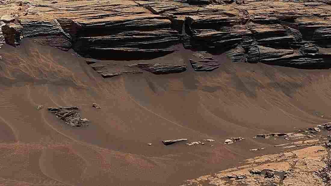 A detail of an image captured by NASA's Curiosity Mars rover shows exposed layers of mudstone and sandstone in contact with one another.